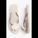 Taupe rubber flip-flops with flower